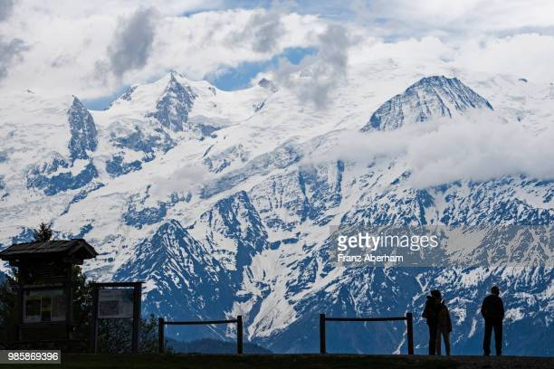 People in front of Mont Blanc massif, Chamonix, France