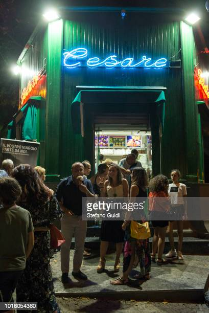 People in front of the Cesare icecream shop during the nightlife in the Via Marina The Via Marina of Reggio Calabria consists of the four streets...
