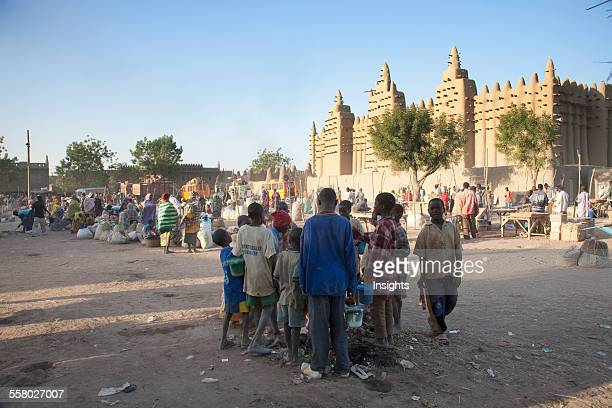 People In Front Of The Grand Mosque At Djenne Mali