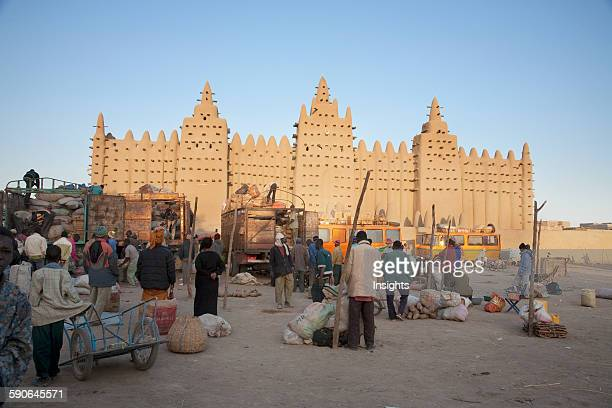 People In Front Of The Grand Mosque Djenne Mali