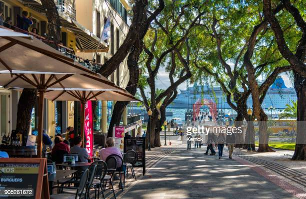 people in funchal,  madeira with view to cruise ship and restaurants - madeira stock photos and pictures