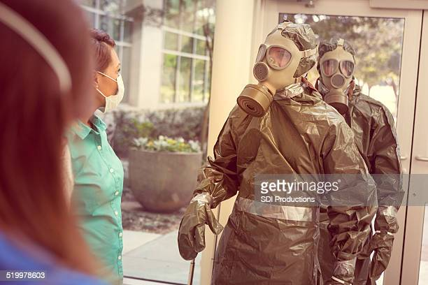 people in hazmat suits entering office for contagious outbreak - epidemic stock pictures, royalty-free photos & images