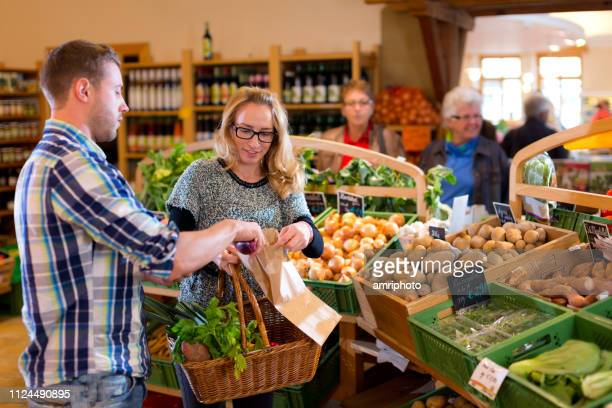 people in health food shop - health food shop stock pictures, royalty-free photos & images