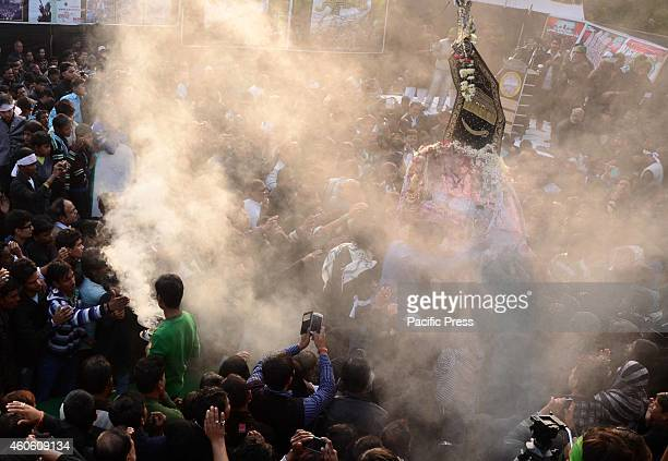 People in holy smoke during the '72 taboot Procession' showing the sacrifices of Hazrat Imam Husain Alaihissalam and his 71 followers in Karbala...