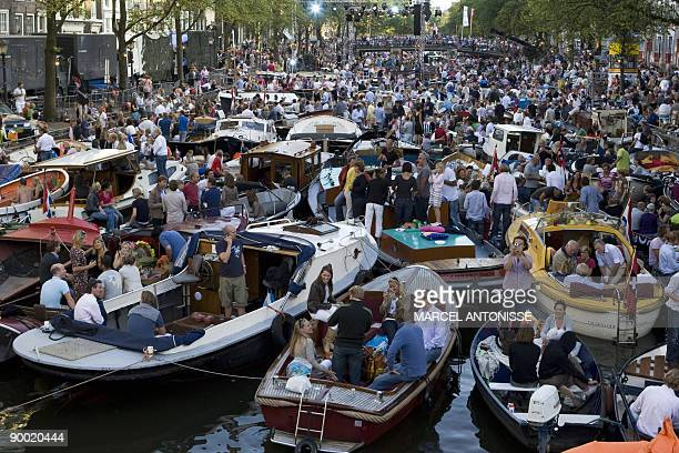 People in hundreds of small boats gather in the canals of Amsterdam to attend the Canal Concert a classical concert performing by soprano Danielle de...