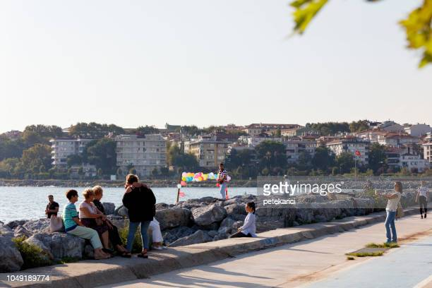 people in kalamis, istanbul - kadikoy stock photos and pictures