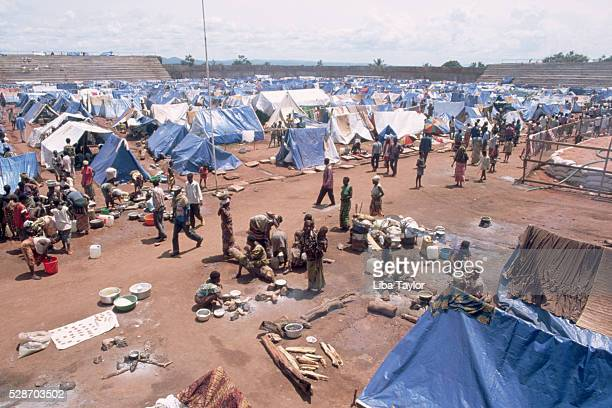 people in kigoma refugee camp - refugee camp stock pictures, royalty-free photos & images