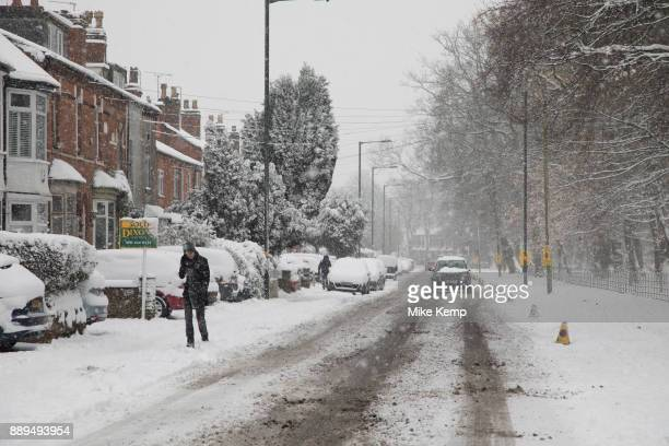 People in Kings Heath head out to enjoy the heavy snow fall on Sunday 10th December 2017 in Birmingham, United Kingdom. Deep snow arrived in much of...