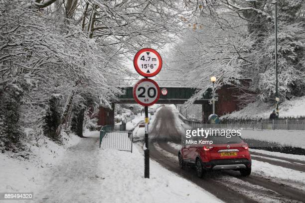 People in Kings Heath head out to enjoy the heavy snow fall on Sunday 10th December 2017 in Birmingham United Kingdom Deep snow arrived in much of...
