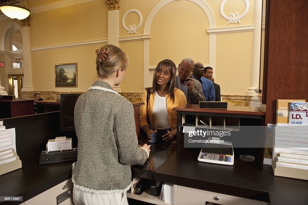 People in line at a bank : Stock Photo