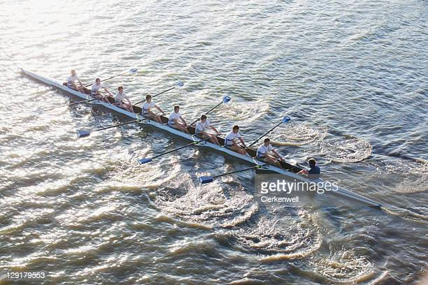 people in long canoe oaring - rowing boat stock pictures, royalty-free photos & images