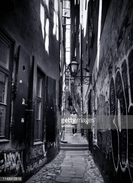 people in mårten trotzigs gränd - the narrowest alley in stockholm, sweden - old town stock pictures, royalty-free photos & images