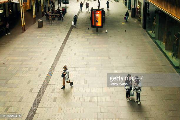 People in masks are seen at Pitt Street Mall on March 26 2020 in Sydney Australia Further restrictions on travel and movement have been put in to...