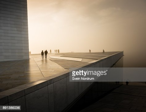 People in misty weather on a roof