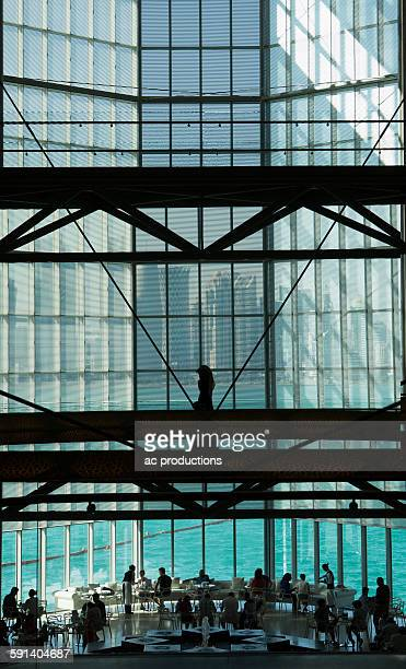 People in modern glass atrium, Doha, Doha, Qatar