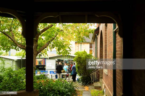 People in need are seen waiting for food items at St Paul's Anglican Church in Burwood on March 24 2020 in Sydney Australia The Parish Pantry...