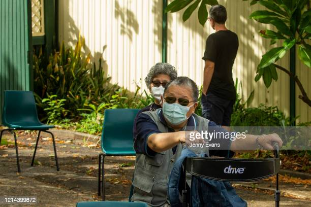 People in need wait for food at St Paul's Anglican Church in Burwood on March 24 2020 in Sydney Australia The Parish Pantry provides food for the...