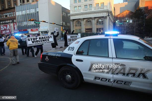 People in Newark march on the second anniversary of the death of 17yearold Trayvon Martin shot and killed by George Zimmerman in Florida in a highly...