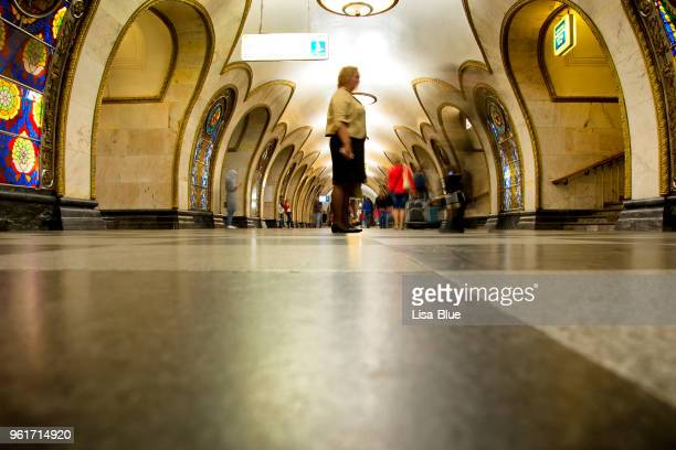 people in novoslobodskaya moscow metro station. - moscow metro stock pictures, royalty-free photos & images