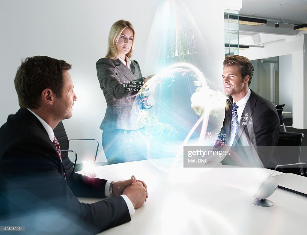 office meeting. People In Office Meeting Looking At 3d Projection From Futuristic Device : Stock Photo E