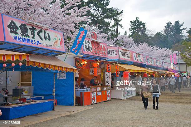 people in park during cherry blossom festival - hirosaki stock pictures, royalty-free photos & images