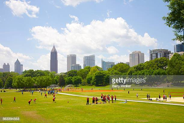 People in park playing kickbball, Atlanta