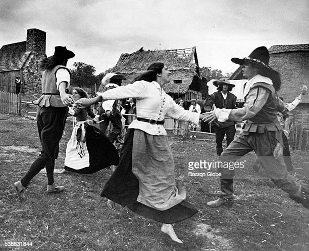 People in period clothing dance during an reunion dinner of the Mayflower II sailing from England to Plymouth Mass at Pilmoth Plantation in Plymouth...