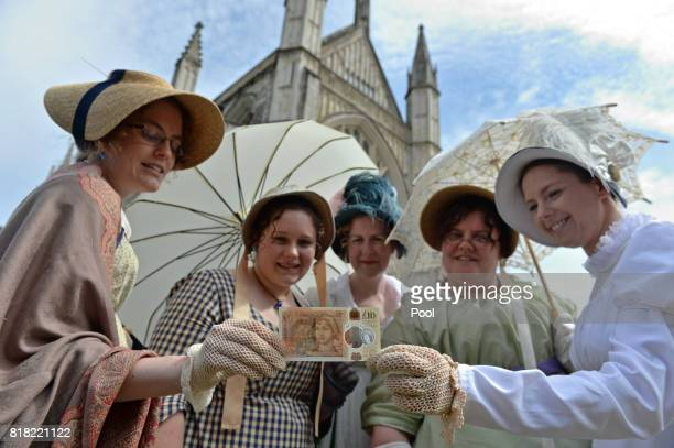 People in period costume pose with one of the Bank of England's new ten pound notes featuring British author Jane Austen during its unveiling at...