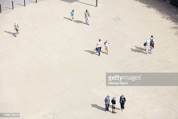 people in plazza seen from above, aerial - courtyard stock pictures, royalty-free photos & images