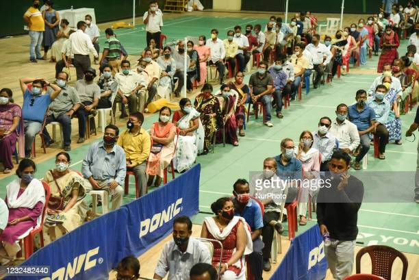 People in queue to get vaccine against Covid-19 coronavirus at an indoor stadium in Guwahati, India on April 23, 2021. India today reported the...