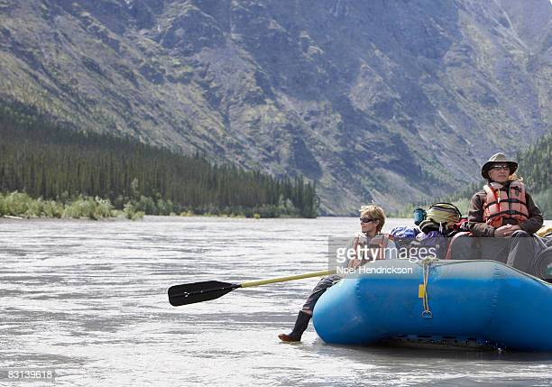 people in raft on river