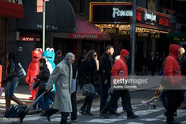 People in red and blue monster costumes in Times Square, New York City