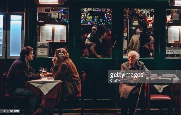 People in Soho district in London in winter
