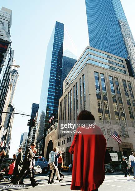 People in street, skyscrapers in background, low angle view