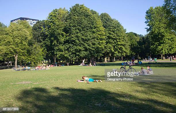 People in summer enjoying the greenery and calm of Het Park central Rotterdam Netherlands