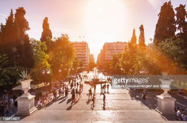 people in sunlight in syntagma square, athens, attiki, greece, europe - シンタグマ広場 ストックフォトと画像