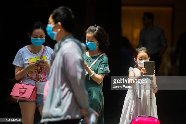 People in Sydney's CBD are seen wearing masks on January 31 2020 in Sydney Australia The World Health Organisation has declared the coronavirus a...