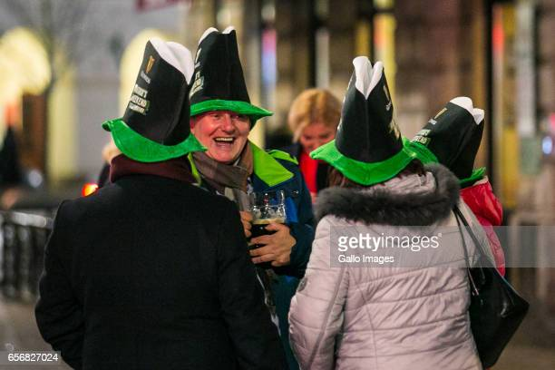 People in symbolic hats in front of the Irish Pub Miodowa seen during Saint Patricks Day celebration on March 17, 2017 in Warsaw, Poland. Saint...