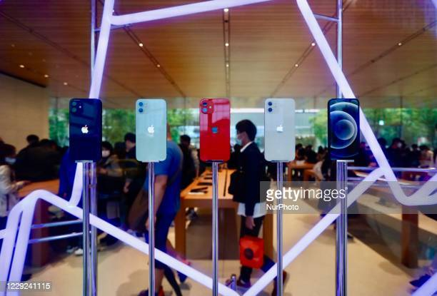 People in Taipei City take photos of Apple's newly released iPhone 12, 12 mini as well as 12 Pro and visit stores to collect their pre-orders, as...