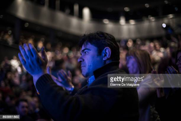 People in the audience applaud a speaker during a meeting of the Ciudadanos party ahead of the forthcoming Catalan parliamentary election on December...
