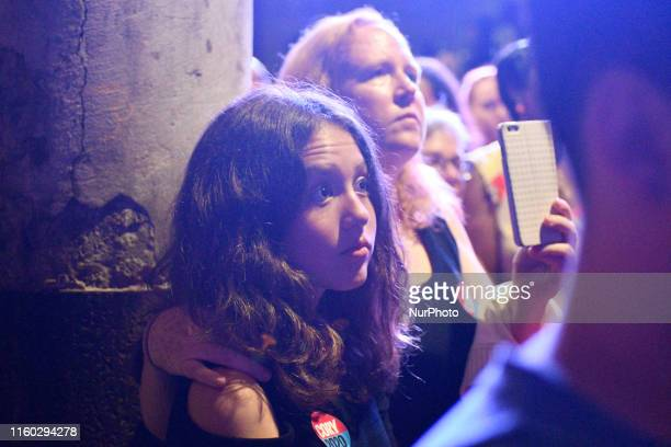 People in the audience listen as Sen Cory Booker Presidential hopeful for the US 2020 Elections takes the stage during a Philadelphia Rise rally at...