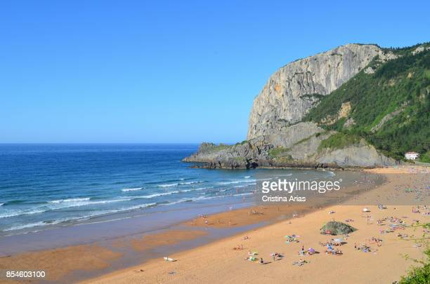 People in the beach of Laga which is located in the Biscayan town of Ibarranguelua , on 17 June 2017, Vizcaya, Basque Country, Spain.