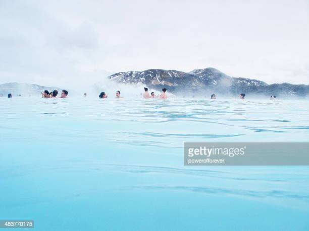 people in the blue lagoon, iceland - blue lagoon iceland stock pictures, royalty-free photos & images