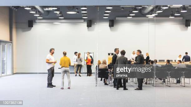 people in the board room - attending stock pictures, royalty-free photos & images