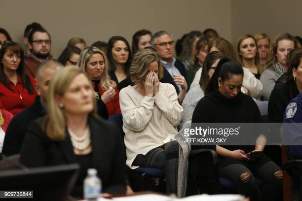 People in the courtroom react as former Michigan State University and USA Gymnastics doctor Larry Nassar listens during impact statements during the...