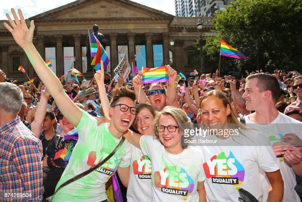 People in the crowd celebrate as the result is announced during the Official Melbourne Postal Survey Result Announcement at the State Library of...