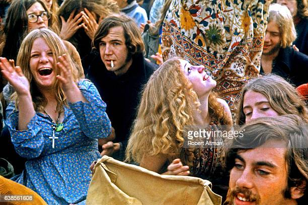People in the crowd cheer as musical acts perform at the Altamont Speedway Free Festival on December 6 1969 in Livermore California