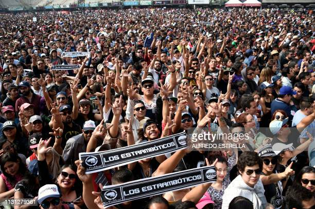 People in the crowd gesture as Mexican band Los Estramboticos performs during the second day of the 'Vive Latino' music festival in Mexico City on...