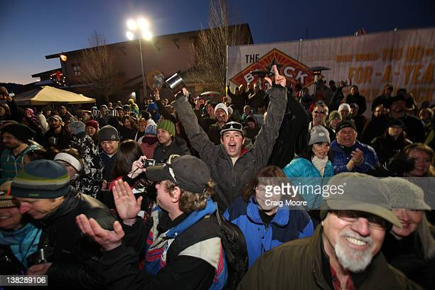 People in the crowd react at the Black Star Beer Barter on February 4 2012 in Whitefish Montana