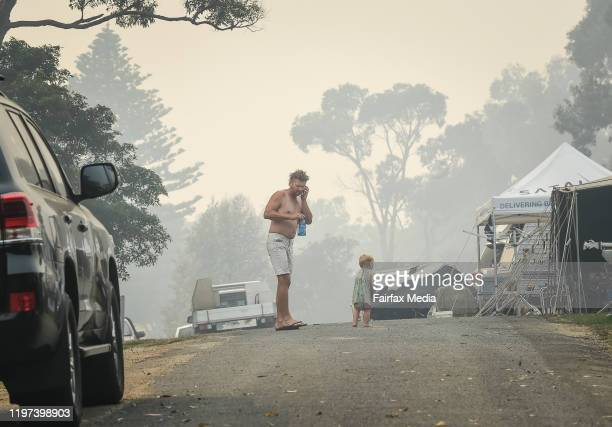 People in the Foreshore Caravan Park who are staying put and see through what will be a day of severe fire conditions in Mallacoota with large fire...